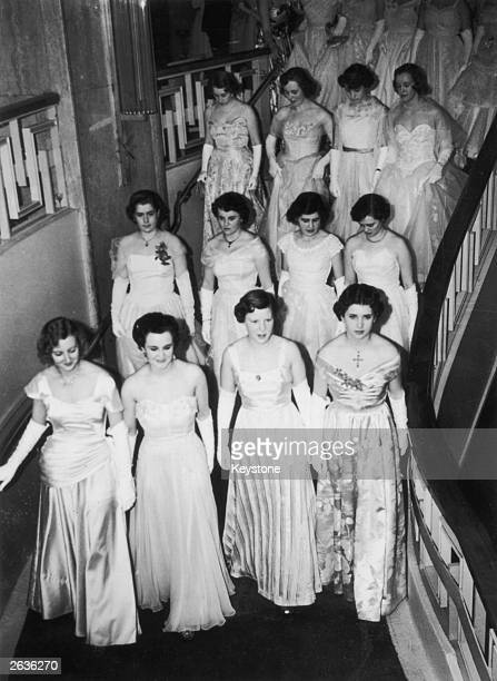 A squadron of debutantes four abreast make a grand entrance at the Queen Charlotte's Ball