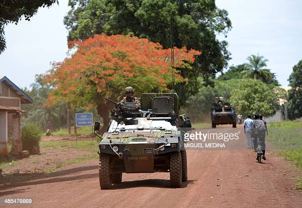 Squadron of the 13th Battalion of Chasseurs Alpins , part of the Sangaris forces, patrol in the streets of Bria on April 18, 2014. UN refugee chief...