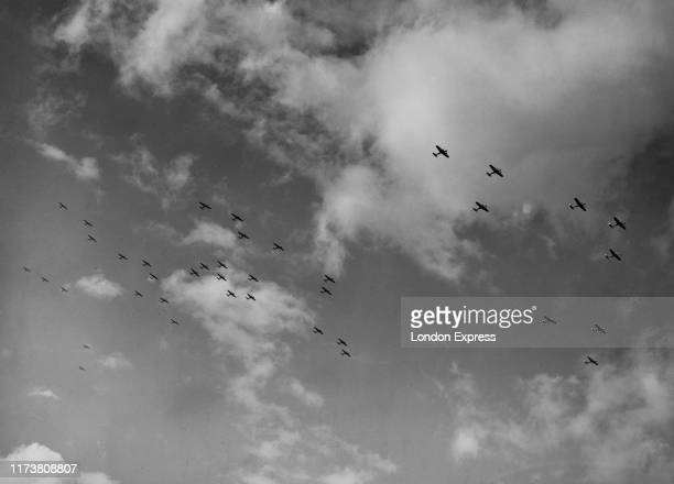 Squadrons of Dornier Do 17E bombers of the German Luftwaffe fly in formation over Vienna after the German Fuhrer and Chancellor Adolf Hitler had...