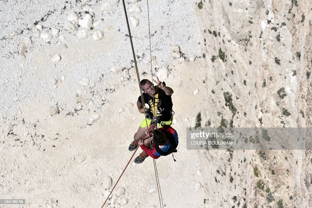 Squad's leader Thomas Zielinski, a former high-altitude worker climbs up after jumping from atop the rugged rocks overlooking the azure waters of Navagio beach, one of the Greece's most renowned leisure spots on the popular tourist island of Zakynthos on June 23, 2014. This is rope jumping -- part diving, part rock climbing, with a touch of engineering. The aim of the project is to dream jump in 80 places with most ravishing nature and architecture all over the world .They plan to stage their next leaps at a cave complex in Croatia, a French viaduct, skyscrapers in Las Vegas and Johannesburg, and the Grand Canyon.