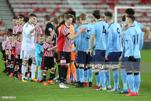 Squads shake hands at the start of the Premier League International Cup match between Sunderland U23 and Newcastle United U23 at Stadium of Light on...