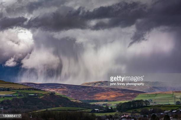 squally weather across kinder scout estate and the peak district national park. - extreme weather stock pictures, royalty-free photos & images