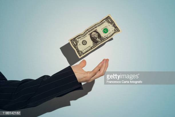 squander money - american one dollar bill stock pictures, royalty-free photos & images