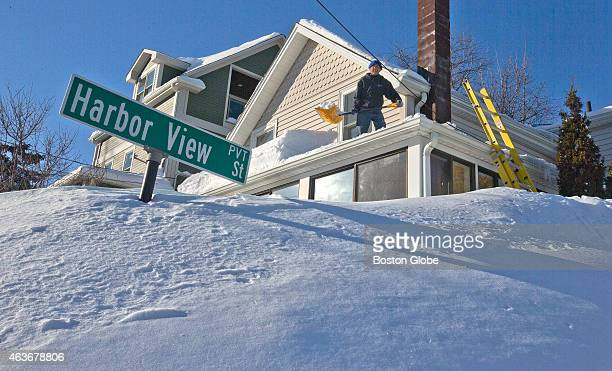Squantum resident removes snow from his Harbor View St home