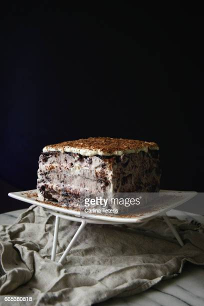 Square black forest cake on a dark background