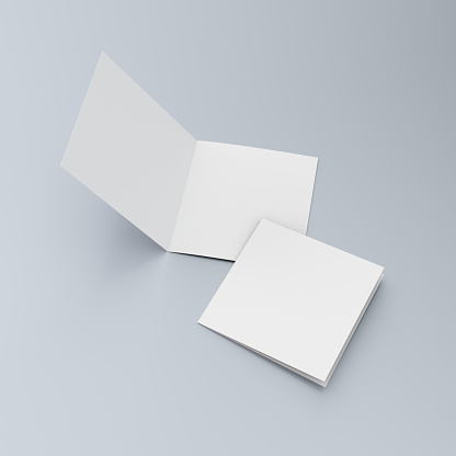 Square blank leaflets or brochures on blue 545359438