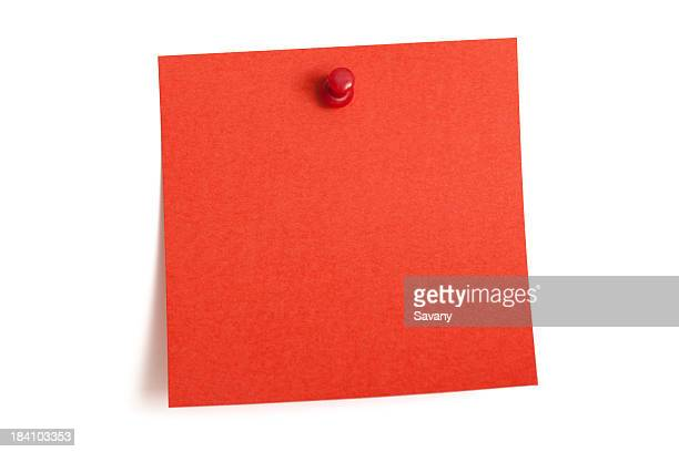 a square blank red note is pinned to a white wall - adhesive note stock pictures, royalty-free photos & images
