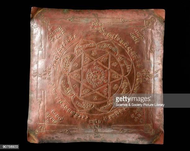 Square bronze Hindu meditation plaque called a yantra.