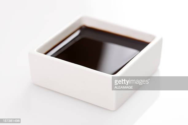 a square container of soy sauce - soy sauce stock pictures, royalty-free photos & images