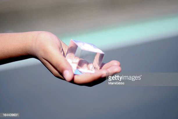 Square glass on the hand.