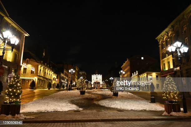 Square Jacques-Cartier, near the Old Port, which usually attracts tourists, is pictured deserted moments after the curfew was implemented from 8pm...