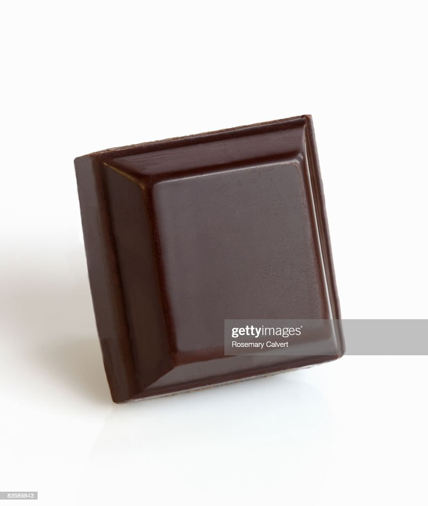 Square of dark chocolate. : Stock Photo