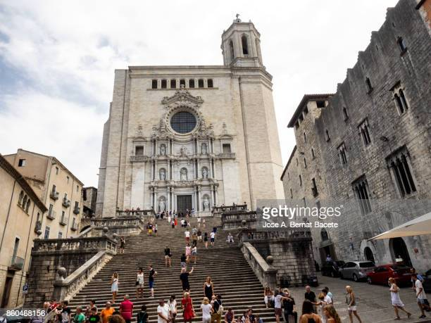square of the cathedral of girona and group of tourists to visit. catalonia, spain - girona stock photos and pictures