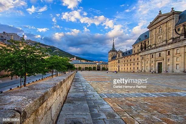 Square of The Monasterio de El Escorial with a dramatic light, and stormy clouds. Madrid. Spain