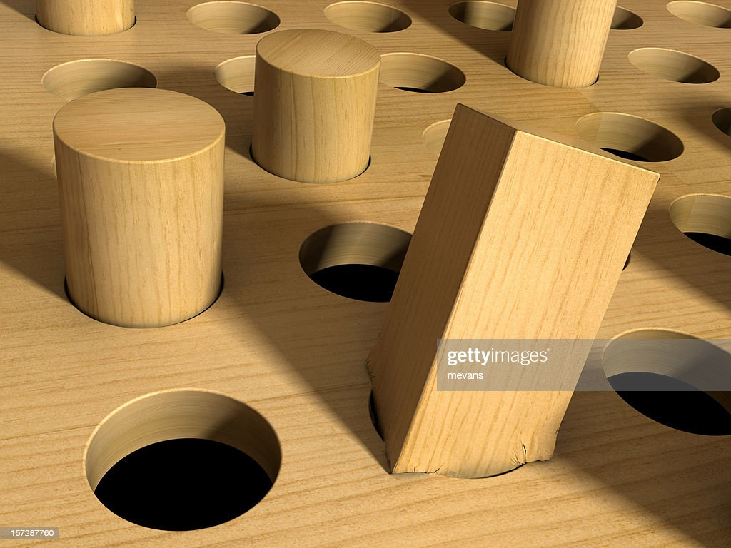 Square Peg in a Round Hole : Stock Photo