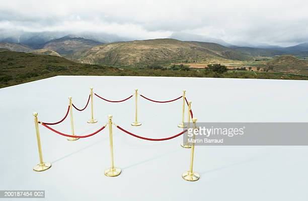 square roped off area on platform overlooking rugged landscape - roped off stock photos and pictures