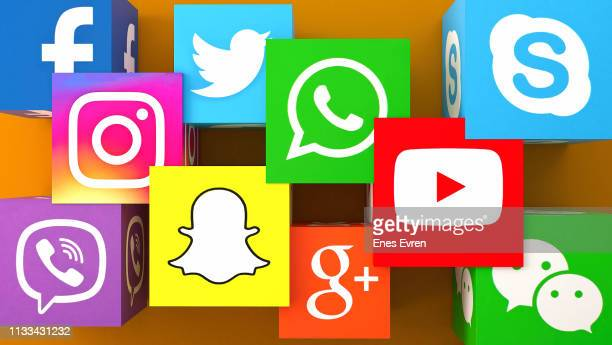 square shape of social media services icons on an orange desk - social media icons stock pictures, royalty-free photos & images