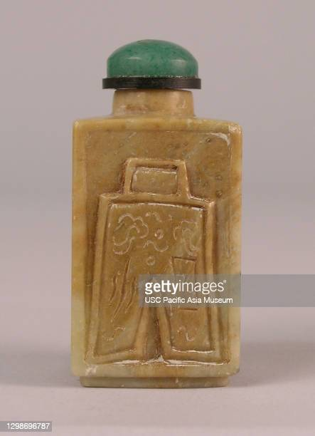 Square shaped snuff bottle with archaic coin in relief on one side and archaic calligraphy on the other side, China, 19th Century, soapstone; bone;...