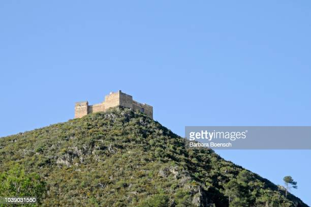 square stone fortress on a hill, forna, valles de la marina, denia, alicante, costa blanca, spain - denia stock pictures, royalty-free photos & images
