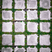 square tiles with green grass