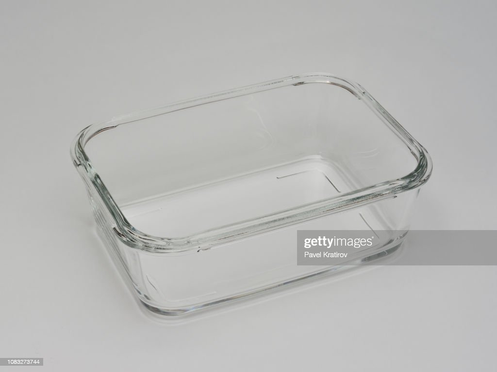 square tray for food and roasting from transparent glass on a gray background : Stock Photo