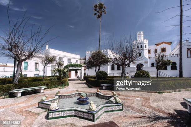 square with fountain in tarifa, spain - tarifa stock photos and pictures