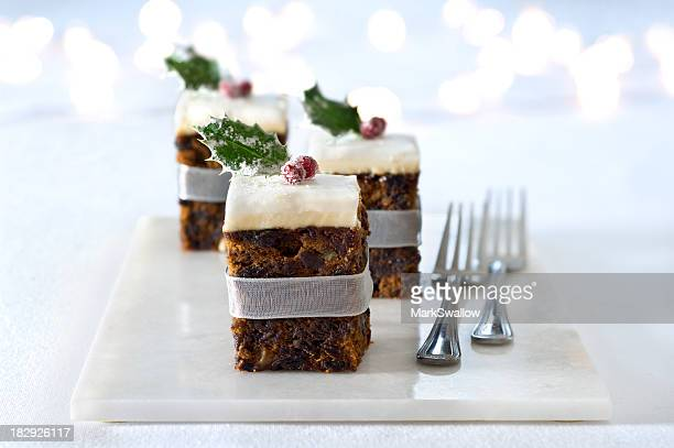 Squares of Christmas cake adorned with a cranberry