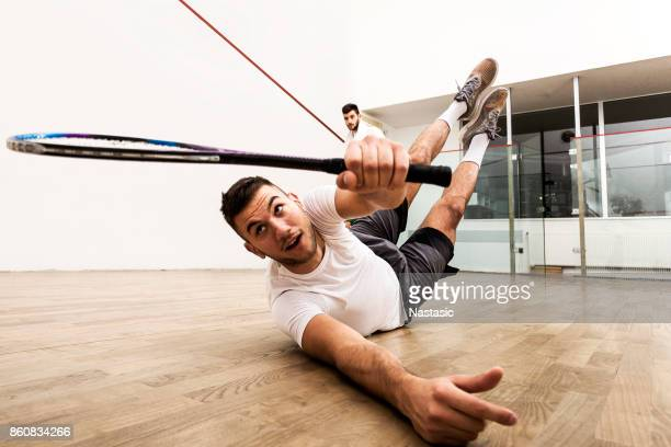 squash player on court - racquet sport stock photos and pictures