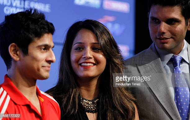 Squash players Saurav Ghosal and Dipika Pallikal with CEO of JSW Sport Mustafa Ghouse during a press conference to announce the JSW Indian Squash...