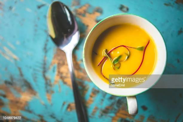squash potage soup in a tea cup - vegetable soup stock pictures, royalty-free photos & images