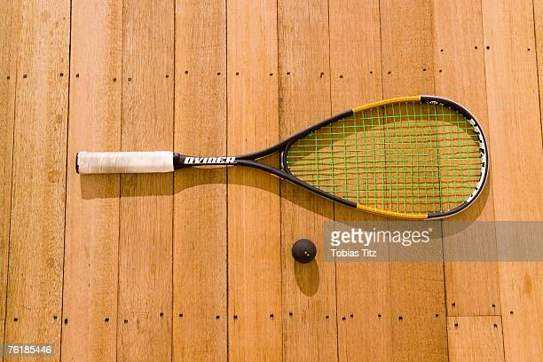 A squash racquet and ball