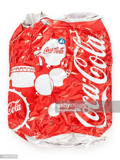 squashed soda can found in street - roadkill stock photos and pictures