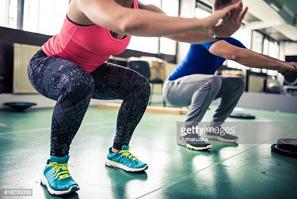 squat everyday - hurken stockfoto's en -beelden