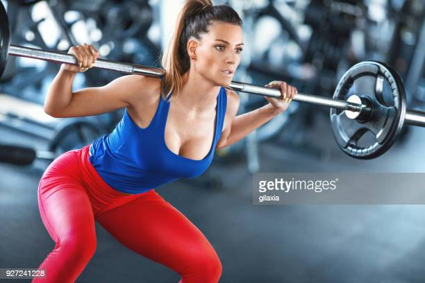 squat workout. - cleavage stock pictures, royalty-free photos & images