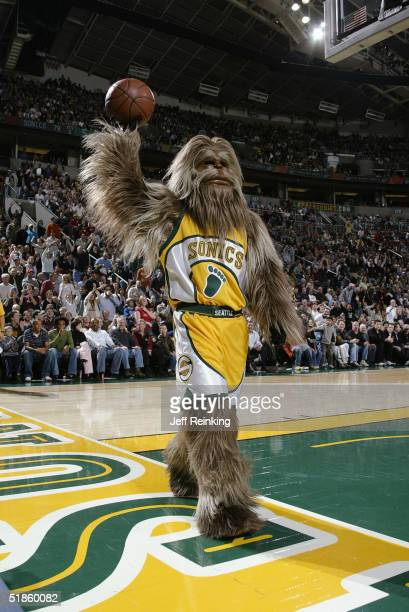 Squatch the Seattle Sonics mascot holds the ball during the game against the New Jersey Nets on November 26 2004 at Key Arena in Seattle Washington...