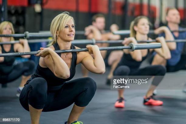 Kniebeugen mit Gewichten