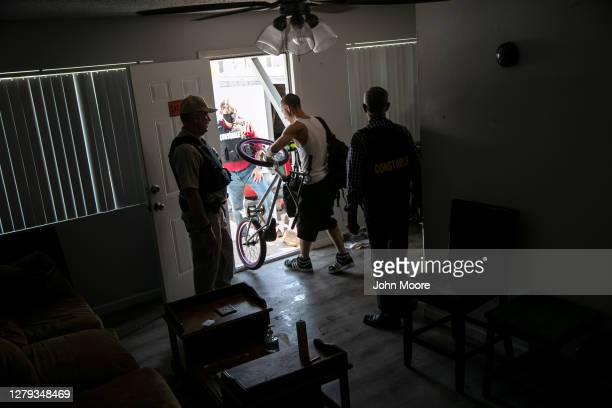 Squatter removes belongings from an apartment as Maricopa County constables serve an eviction order on September 30, 2020 in Phoenix, Arizona....