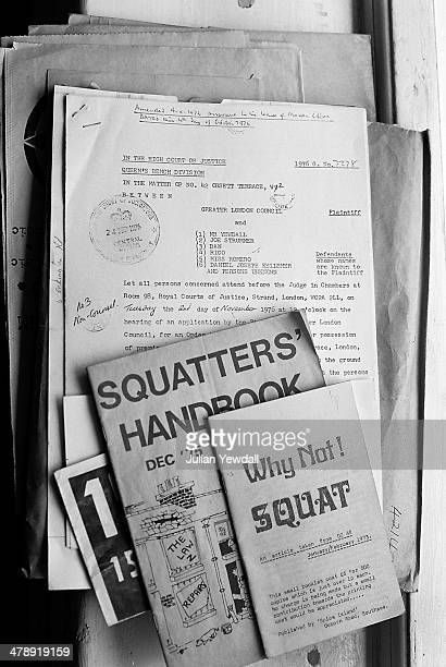 Squatters' handbooks and a document dated 24th September giving notice of a court hearing for a possession order on 42 Orsett Terrace London W2 a...