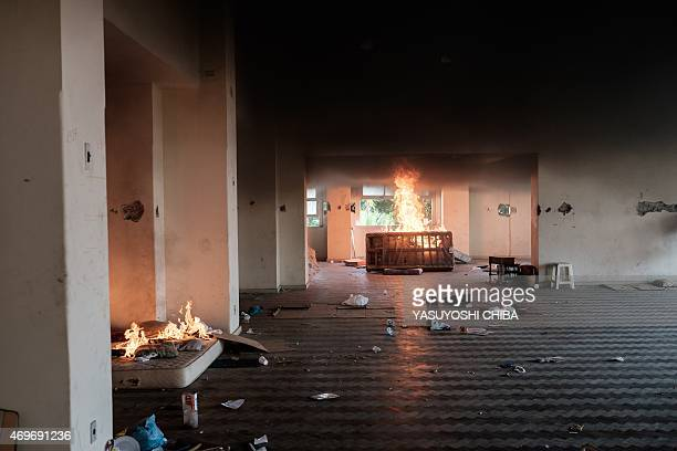 Squatters set mattresses on fire after accepting an offer from the City Hall to leave the occupied building in Flamengo Rio de Janeiro Brazil on...