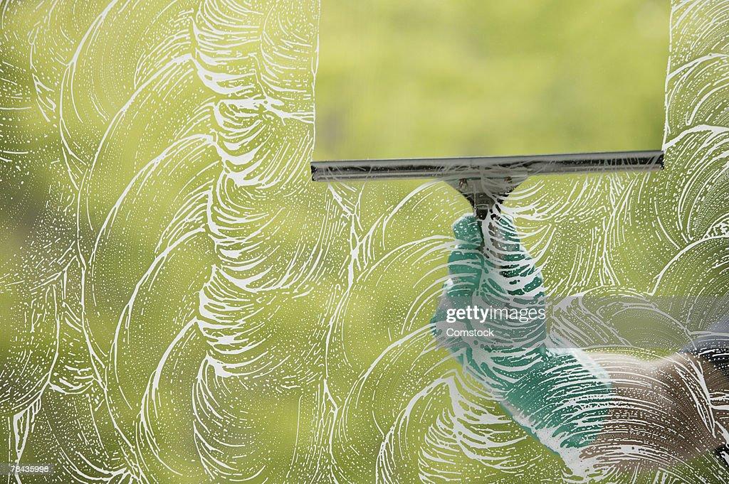 Squeegee wiping window : Stockfoto