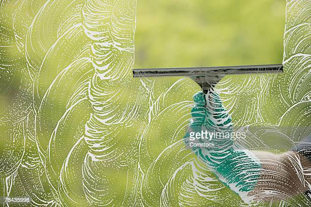 Squeegee wiping window
