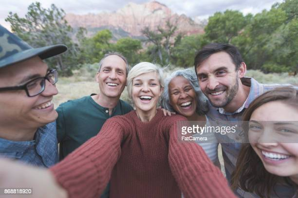 squeeze in for a group photo! - baby boomer stock pictures, royalty-free photos & images