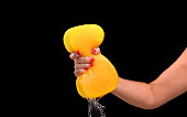 strong woman squeezing sponge with water