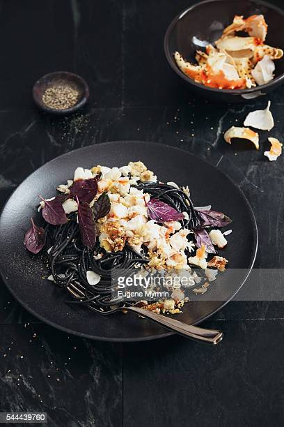Squid ink pasta with crab meat, breadcrumbs and basil