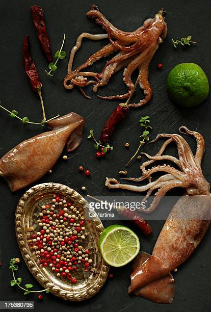 Squids ingredient shot with lime and pepper