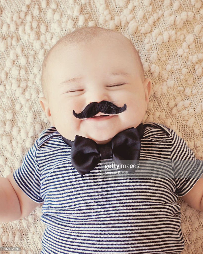 Squinty eyed baby with mustache : Stock Photo