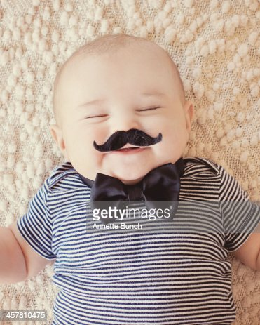 Squinty eyed baby with mustache