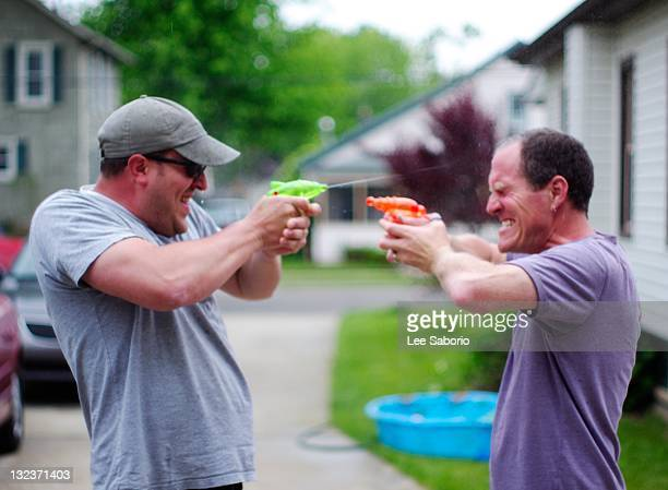 squirt gun fight - adults only stock pictures, royalty-free photos & images