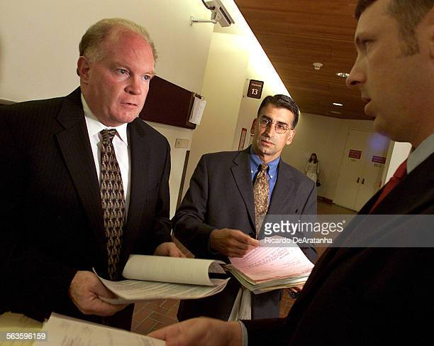 Sr Deputy District Attorney Bill Redmond left discussing today's court cases outside courtroom 11 at Ventura County Superior Court with Sr DDA John...