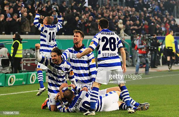 Srdjan Baljak of Duisburg celebrates with his team mates after scoring his team's second goal during the DFB Cup semi final match between MSV...